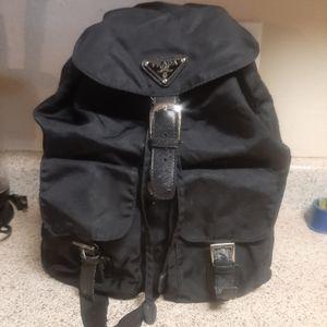 Black, nylon prada milano dal 1913 backpack.